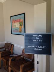 Sign in Paradise lobby welcoming the Tampa Bay Business Journal.