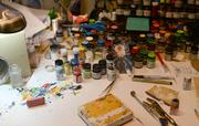 Each pedal is hand painted. This is the workspace of one of the artists.