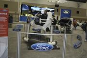Ford is offering people a chance to try their hand at racing in this simulator, which spins to give the feeling of motion.