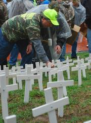 Union protestors plant crosses, representing mine fatalities, at a rally at Kiener Plaza in downtown St. Louis on April 16.