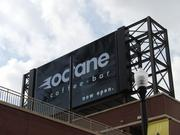 An ad for the Octane Coffee Bar appears on the screen above Uptown.
