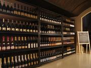 """Fat Cork's """"cave,"""" a temperature-controlled storage room, has 70 different Champagnes from 12 different growers."""
