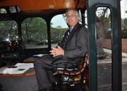 Steven Abrams, the Palm Beach County mayor, rides on the trolly between the Broken Sound clubhouse and the fitness center.