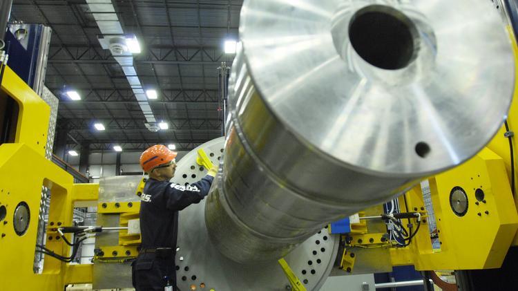 A Vestas technician works on a nacelle.