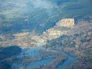 An aerial photo shows the wide pathway of a mudslide that hit March 22 near Oso east of Arlington in Snohomish County.