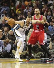 Marc Gasol is held by the Bulls' Carlos Boozer