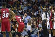 A Grizzlies fan attempts to distract Heat guard Dwyane Wade