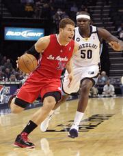 Clippers forward Blake Griffin drives against Zach Randolph