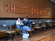 The new Whistling Kettle Tea Shop & Cafe will host a grand opening today in Troy, NY. Here, Russell Sage College students Danielle Giammatteo, left, and Christie DeVantier chat at the cafe.
