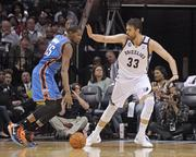 Center Marc Gasol flashes out to Thunder forward Kevin Durant