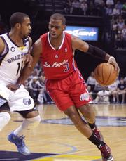 Clippers guard Chris Paul drives against Mike Conley