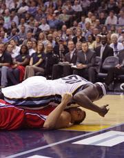 Grizzlies forward Zach Randolph falls on top of Blake Griffin
