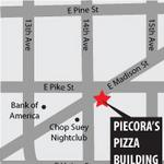 Demolition underway at Piecora's Pizza building in Capitol Hill