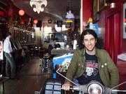 Haymarket Whiskey Bar owner Matthew Landan is shown inside his bar on E. Market Street.