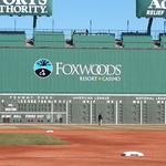 There are two new corporate names on the Green Monster this season