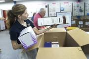 Tammy McDill checked expiration dates on donated medical supplies.