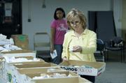 Donna Meador and Tawana Shaffer distributed medical supplies.
