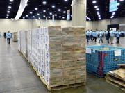 Boxes of donated items are stacked on pallets ready to be delivered to those in need.