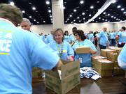 Carlotta Archuleta, center, of The Kroger Co.'s King Soopers division, packed supplies. She is from Greeley, Colo.