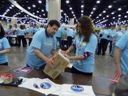 Robert Salomon of Loveland, Colo., and Monique Averill of Columbus, Ohio, labeled boxes of donated products.