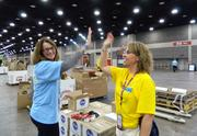 Linda Hurst, left, of Atlanta and Jacqui Fritz of Louisville gave each other high fives as The Kroger Co. Give A Day service event wound down.