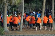 The team from Shepard Exposition Services does some stretching by the shore of Lake Eola before the start of the 5k.