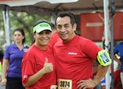 Vilma Vela of Florida Hospital had her husband, Davis, join her company team since his company was not entered in the 5k.