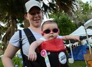 Four-month-old Riley Ruiz hangs with mom, Shana, at the Orange Lake Resorts team tent.