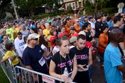 Participants crowd the stretch of Eola Avenue between Central Avenue and Robinson Street before the start of the race. And this is just the walkers.