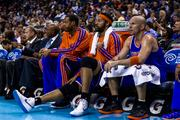 Rasheed Wallace (center) sits between fellow veterans Marcus Camby, left, and Jason Kidd, during a 106-95 loss to the Charlotte Bobcats on April 15, 2013.
