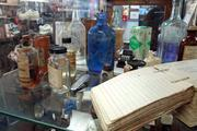 Inside Burton's Pharmacy, which will leave downtown Greensboro at the close of business on Tuesday, is a collection of owner Frank Burton's antique pharmacy items, including items from Elm Street Pharmacy, the business's predecessor that opened on North Elm Street in 1927.