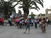 Protesters circled outside the SJSU Events Center before Hillary Clinton's speech, calling for the former Secretary of State to answer for a 2012 attack on the U.S. embassy in Libya that killed four.