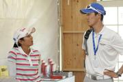 Ai Miyazato, left, and her traveling manager, Takumi Azoya, wait in the media center at the LPGA LOTTE Championship.