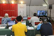 Reporters covering the LPGA LOTTE Championship work in the Media Center on the grounds of the Ko Olina Golf Course.