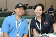 Nathan Kam, left, vice president in travel and tourism division for McNeil Wilson Communications, who volunteered his time at the LPGA LOTTE Championship, with Candice Lee Kraughto.