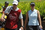 Hawaii golfer Stephanie Kono with her caddy