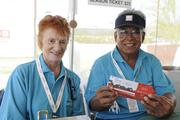 Volunteers for LPGA LOTTE Championship ticket sales Lila Curiel, left, and Simeon Gabay.