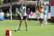 Hawaii golfer Stephanie Kono teeing off from the first hole.