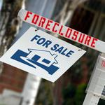 Home foreclosures dropping to levels seen in 2006