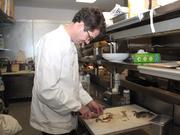 Chef Carl Thorne-Thomsen prepares a soft-shell crab.