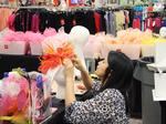 Dillard's uses Derby hats, fashion designers to draw consumers