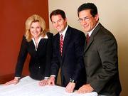 VP and Director of Development Edna Trimble, President and CEO Steven McCraney, and CFO James Marvel.