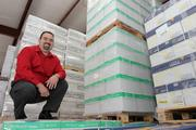 Apex Office Products Inc.'s Alex Llorente in his warehouse with product ready to deliver.