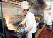 Thunder Valley sous chef Edward Dreher prepares stir-fried eggplant.