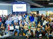 VML employees celebrate their new client, Krispy Kreme, with donuts. VML delivered the iconic donuts to every VML office in the U.S.