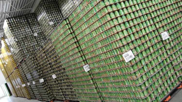 Thousands of freshly brewed Summit beer cans wait to be distributed.