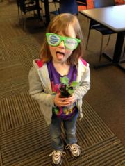 One employee's daughter flashes her stunner shades at Cerner Corp.