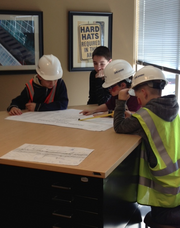Kids at BHC Rhodes don construction hats before plotting out their design.