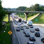 Snapshot: Report: Buffett takes big loss on Coke stock + Atlanta NOT on worst traffic list