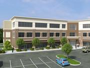 The planned three-story building at 506 Battleground Ave. will be built on an about 1-acre tract adjacent to the existing Deep Roots Market, which lies along the future path of the Downtown Greenway and overlooks NewBridge Bank Park. Project plans include ground-floor retail and two stories of Class A office space.